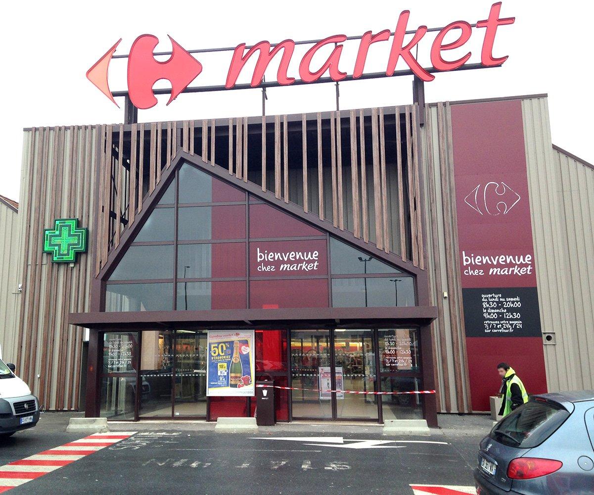 habillage façade supermarché en métal